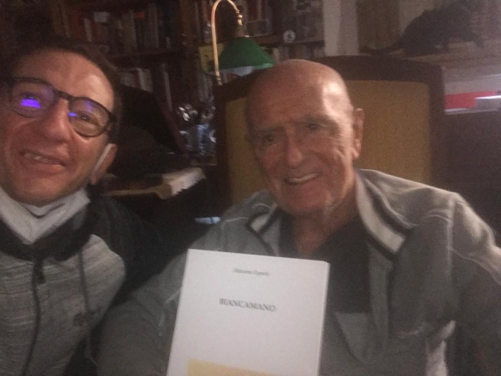 La consegna della prima copia a Mino Milani